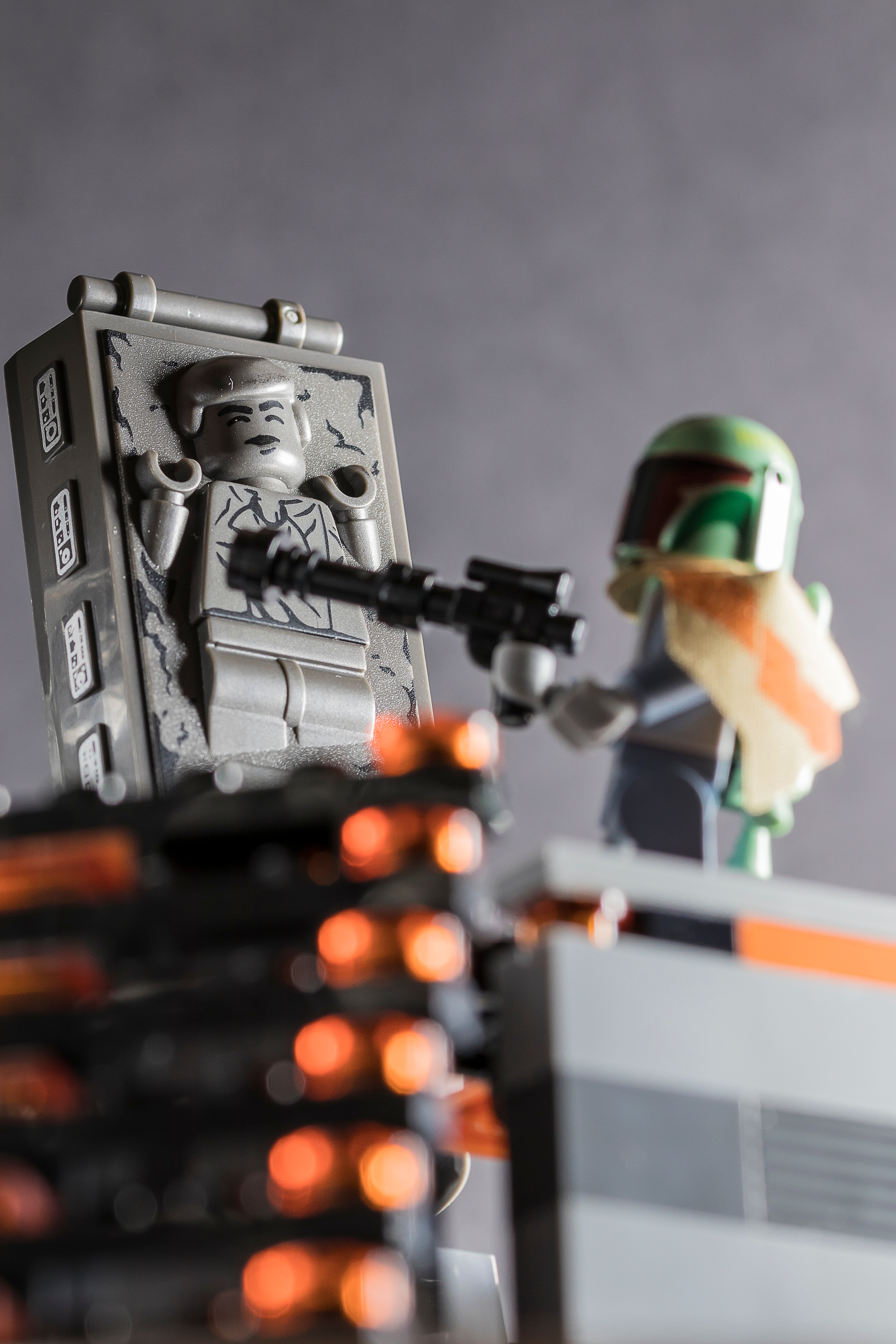 Scene of LEGO toys: Boba Fett confronting Han Solo, who is frozen in carbonite.